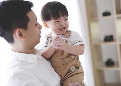 Boy portrait with parent