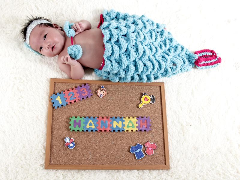 newborn baby girl in mermaid costume