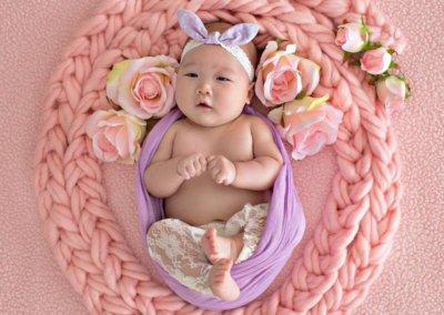 artistic newborn baby girl