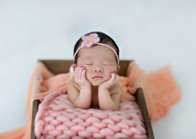 artistic newborn baby girl in the box