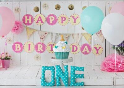 One year bluish pinkish cake smash