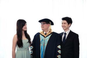 dad graduate portrait with children